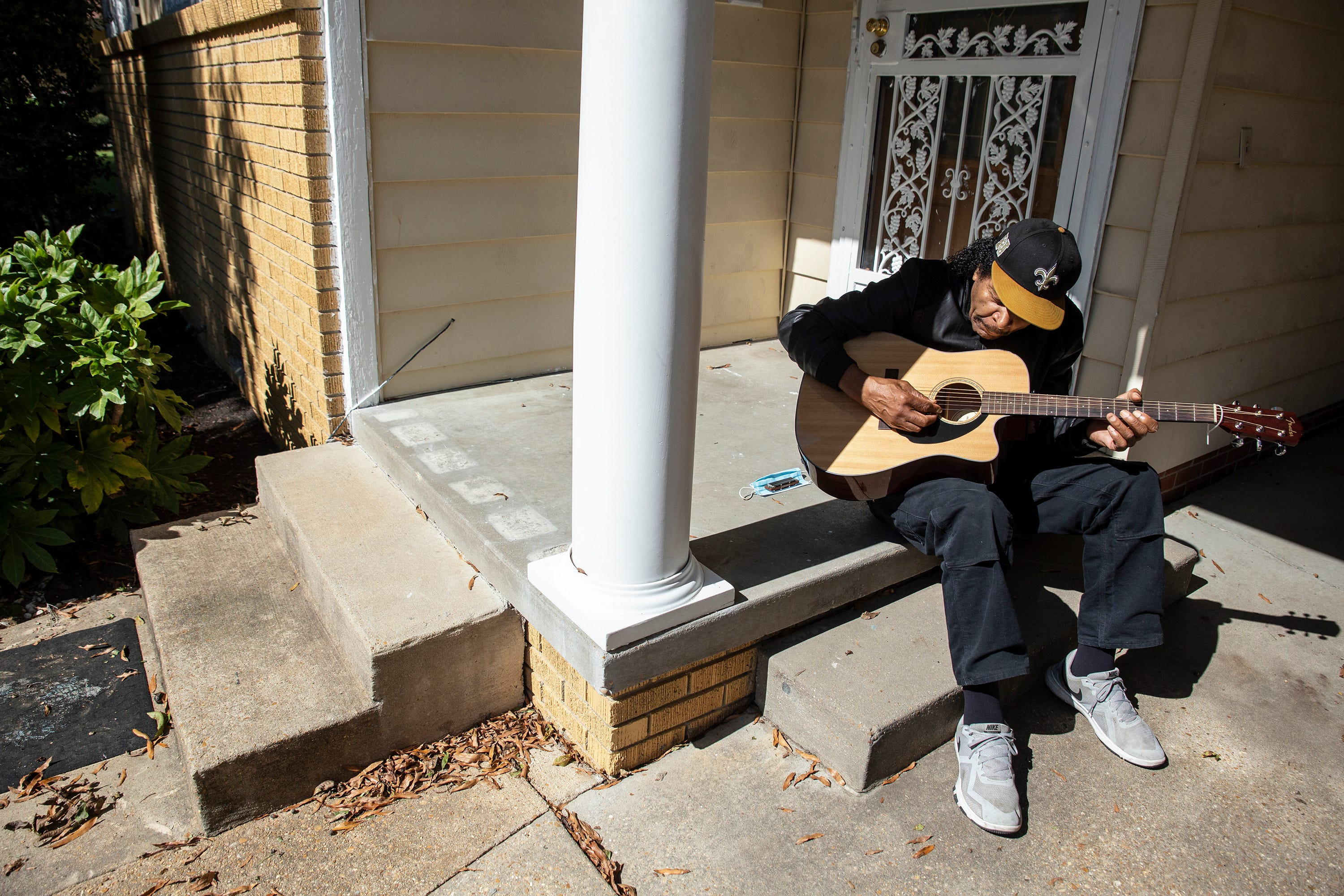 Bobby Rush plays music on his front porch in Jackson, Miss. Friday, Oct. 30, 2020.
