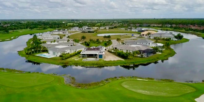 Every home in Peninsula at Treviso Bay overlooks a lake and the finishing holes of the community's TPC golf course.