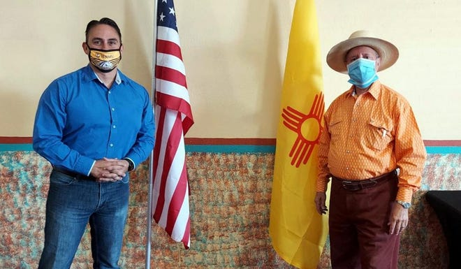 On a recent visit, New Mexico Lt. Gov. Howie Morales, at left,presented Columbus Village Mayor Esequiel Salas with a certificate of outstanding achievement for his leadership during the coronavirus pandemic. Morales commended Salas for his ability to improvise and create solutions in the village with the resources that are available. Mayor Salas takes in community concerns and works with the community to foster their needs.