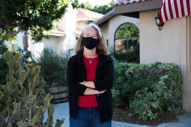 Teri Hargreaves in front of her Cathedral City home last year.