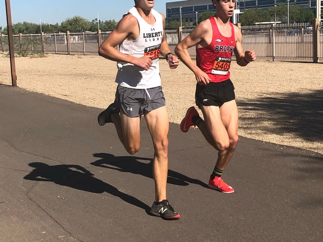 Nov. 5, 2020; Brophy Prep boys cross-country runner Xander Black runs in the Southwest Section state championship qualifier race alongside Liberty's Dan Foster.