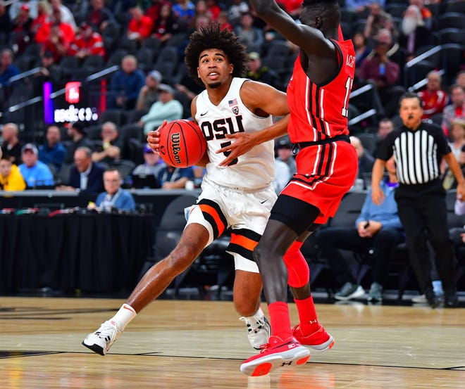 Oregon State Beavers guard Ethan Thompson (5) drives against Utah Utes guard Both Gach (11) during the second half at Mobile Arena.