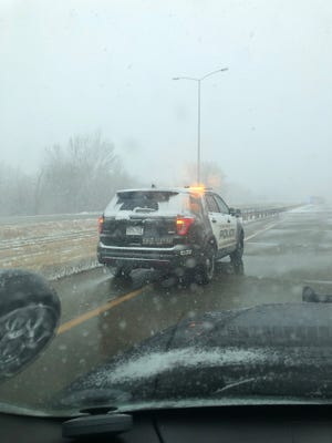 South Dakota Highway Patrol shared an image of an officer working near the scene of an I-229 crash that left two dead Tuesday.
