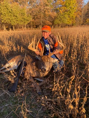 Cole Huwar, 9, shot this 17-point  buck, with a rack measuring 201 7/8 inches, in his dad's soybean field.