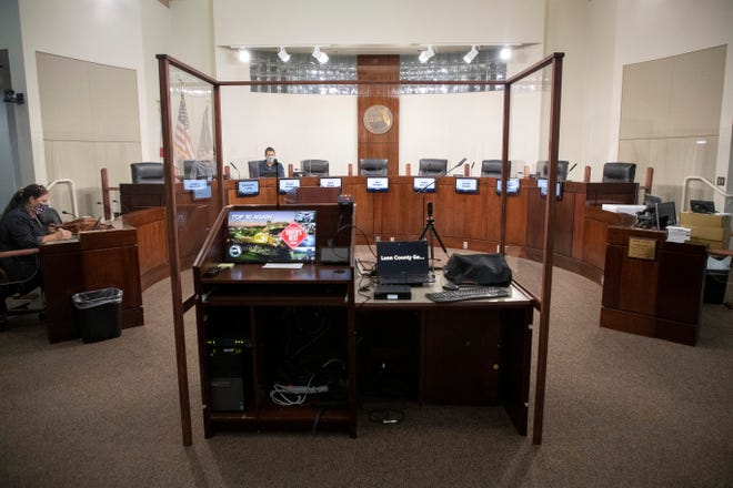 Leon County staff work to test the equipment in the County Commission chamber which as been outfitted with plexiglass between commissioners on the dias and Zoom capabilities the day before the body is set to meet back in person Tuesday, Nov. 9, 2020.