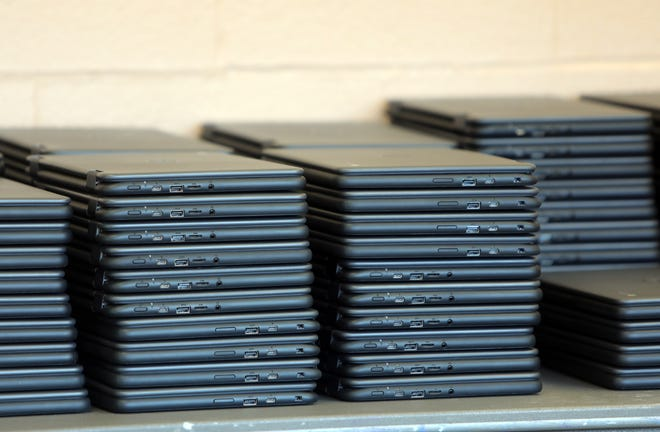 After months of delays, East Ramapo school district has begun distributing thousands of Chromebooks for students Nov. 10, 2020 at Chestnut Ridge Middle School in Chestnut Ridge.
