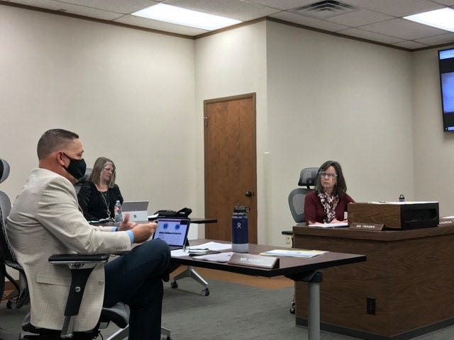 Wichita Falls ISD Superintendent Mike Kuhrt talks to school board President Elizabeth Yeager during a special session on Nov. 10, 2020.