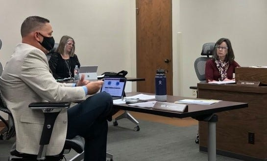Wichita Falls ISD Superintendent Mike Kuhrt, left, talks to school board President Elizabeth Yeager, right, and other trustees not pictured during a special session on Nov. 10, 2020.