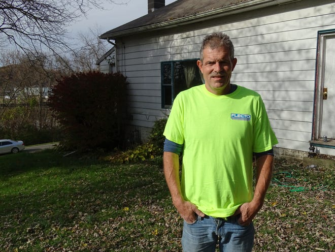 Shad Gordon stands outside of his Zanesville home, with a newly patched roof. Gordon's roof was leaking and he started saving money to fix it butthat changed last monthwhen he received a colon cancer diagnosis. That's when his manager and co-workers from Flecto stepped in to help.