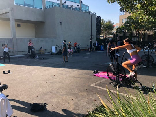 Basecamp Fitness uses an outdoor area near their still-closed studio to host workout classes.