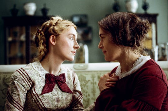 """Charlotte (Saoirse Ronan, left) and Mary (Kate Winslet) fall in love in Francis Lee's Oscar hopeful """"Ammonite."""""""