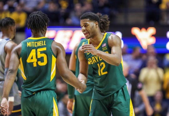 Baylor returns guard Jared Butler (12) and guard Davion Mitchell (45) in this year's quest for a NCAA national title, shown during a game last season at West Virginia.