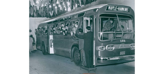 The children of Akron Transportation Co. employees crowd into a new Metroliner on Nov. 21, 1960, during an open house at the garage at 420 Kenmore Blvd. The company bought 10 diesel buses that cost $25,000 each.