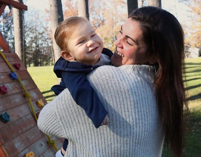 Carlla Detwiler holds her nineteen-month-old son David at their home Sunday, Nov. 8, 2020 in Massillon, Ohio. David has no functioning kidneys, is  blind and now has cerebral palsy but despite all of his physical setbacks, his parents wouldn't change a thing and are thankful for him.