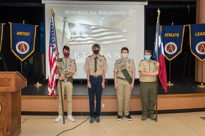 A group of Ascension Academy Boy Scouts participate in Wednesday morning's Veterans' Day chapel service.