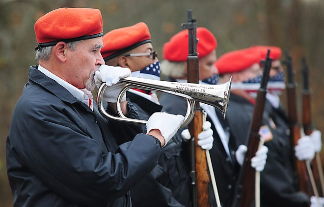 Gary Ickes plays Taps at the conclusion of Wednesday's Veterans Day service at Disabled American Veterans Chapter 50 in Lexington Township.
