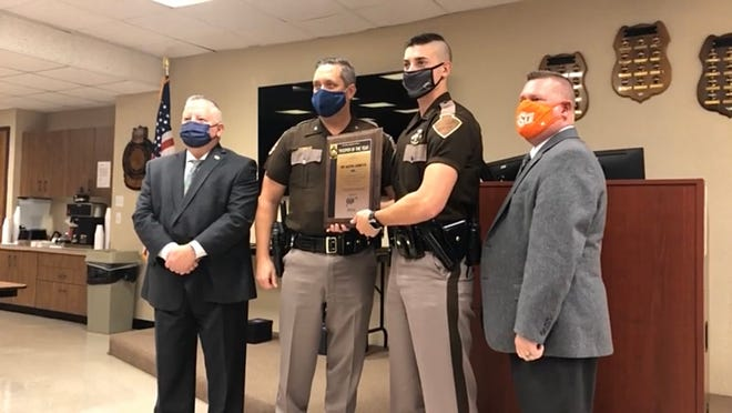 OHP Trooper Austin Ludwyck is presented with the 2019 Trooper of the Year award for humanitarianism during a small, virtual celebration Tuesday.