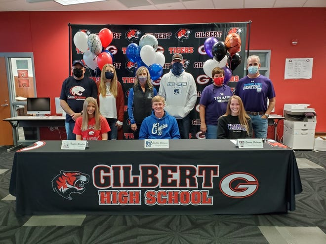 Three Gilbert students signed a letter of intent to play college sports on Wednesday. The group posed together Tuesday due to not having school Wednesday. Signing for Gilbert were, from left, Taylor Grinley (with parents Craig and Amy Grinley), Easton Johnson (with parents Kurt and Jacy Johnson) and Emma Bulman (with parents Jeff and Tami Bulman). Grinley signed to play women's volleyball at South Alabama, Johnson baseball at Creighton an Bulman woman's basketball at Truman State.