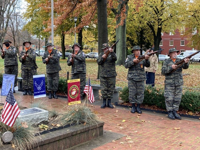 Seven honor guards fired a three-volley salute at a Veterans Day ceremony Wednesday at the Vietnam Memorial on Third Street in Beaver.