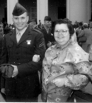 New U.S. Marine Mike Tupa poses with mom at boot camp in 1980's.