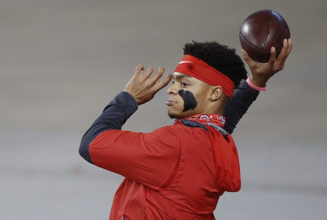 Ohio State quarterback Justin Fields will be idle this week as the Buckeyes' game at Maryland was canceled because of the coronavirus outbreak among the Terrapins.