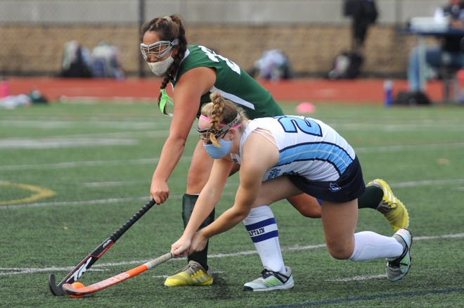 D-Y's Caitlin Walsh, left, and Sandwich's Maura McIver battle for a ball in first-quarter action of Wednesday's Cape & Islands Atlantic semifinal matchup. See more photos from the game: capecodtimes.com/photos