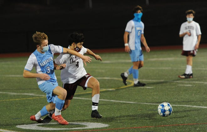 Sandwich's Benjamin Sutton, left, and Falmouth's Lucas Reis go after the ball in the Cape & Islands League Atlantic tournament Tuesday afternoon.