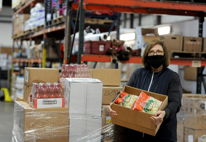 Catherine D'Amato, executive director of the Greater Boston Food Bank, visited the Family Pantry of Cape Cod in Harwich Monday morning. The food bank made deliveries not only to the Harwich pantry, but to other organizations around the Cape.
