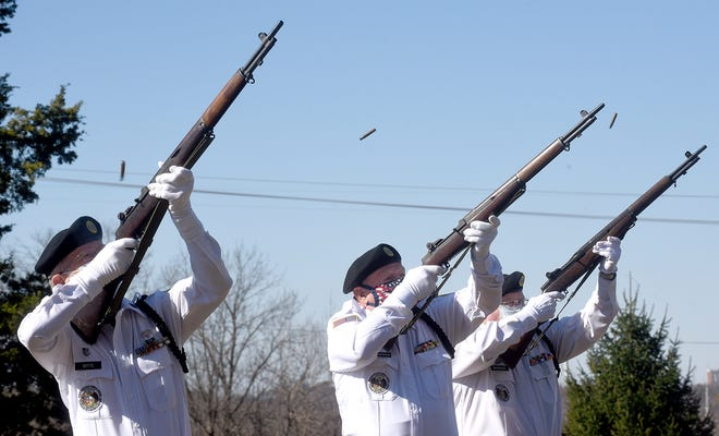 Legion honor guard members — from left, John Witte, John Hendrickson and Melvin Bradley — fire their M1 Garand rifles during a three-volley salute Wednesday.