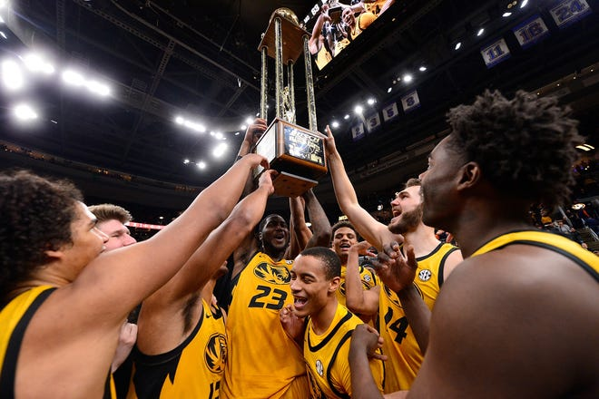 The Missouri Tigers hoist the Braggin' Rights trophy after defeating the Illinois Fighting Illini at the Enterprise Center last December.