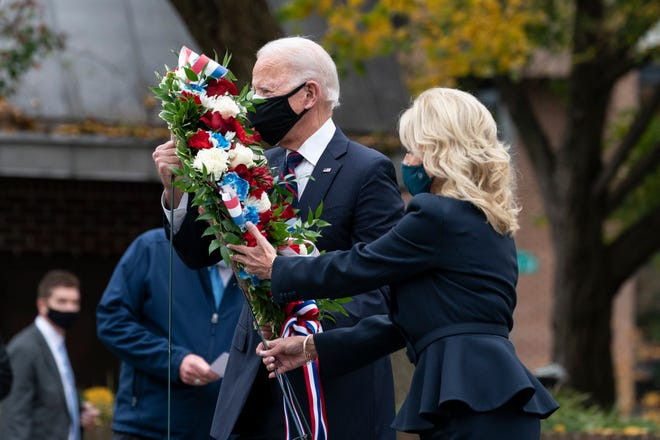 President-elect Joe Biden, and Jill Biden, place a wreath at the Philadelphia Korean War Memorial at Penn's Landing, on Veterans Day in Philadelphia.