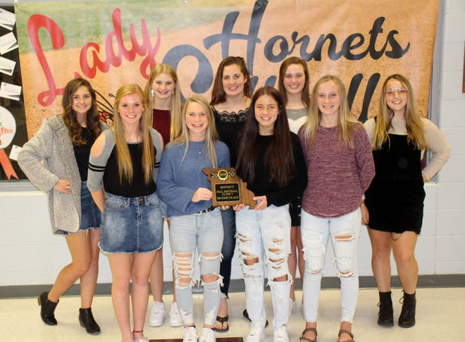 Nine members of the 2020 Midland Empire Conference softball champion and district-runnerup Chillicothe High School softball Lady Hornets received some level of postseason recognition for their contributions to the team's outstanding campaign, it was recounted by head coach Lee Rucker during last Monday's postseason awards event at the school. That group included, from left: Front – shortstop Kirsten Dunn, outfielder/pitcher Mollie Ellis, pitcher/third baseman Halle Rucker, catcher/outfielder Hope Helton; Back – center fielder Sophia Luetticke, second baseman Bre Pithan, first/third baseman Brooke Horton, pitcher/first baseman Kinlei Boley, and outfielder/catcher Mika Hibner. Luetticke, who broke CHS records for highest batting average, hits, and runs scored in a season, received the highest postseason laurel, being voted to the Missouri High School Fastpitch Coaches Association's Class 3 All-State second team.