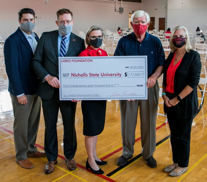 Dignitaries hold a ceremonial check from the Lorio Foundation signifying its donation for renovations to the Shaver Gymnasium at Nicholls State University. From left: Jeremy Becker, executive director of the Nicholls Foundation, Dr. Jay Clune, Nicholls President, Allison Clune, Nicholls First Lady, Cam Morvant, chairman of the Lorio Foundation and Monique Crochet, executive director of external affairs at Nicholls.