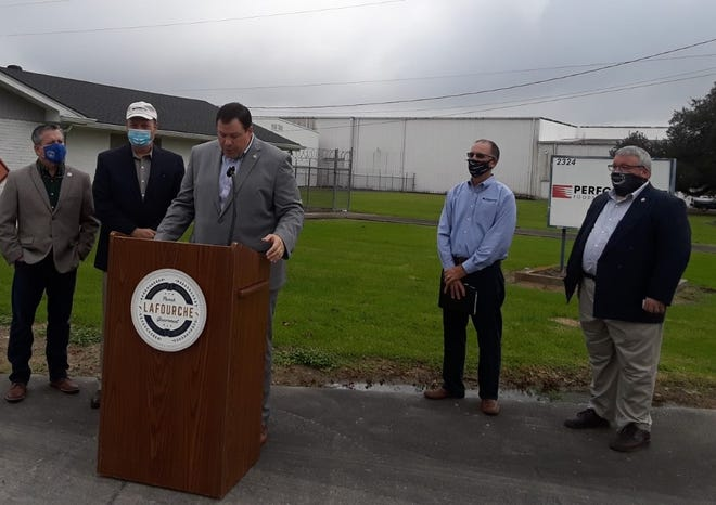 Lafourche Parish President Archie Chaisson announces a $25 million expansion of Performance Foodservice – Caro during a news conference Wednesday.