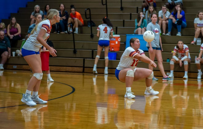 Randleman's Kylie Vaughan sets the ball against Ledford during a match on Aug. 21, 2019.