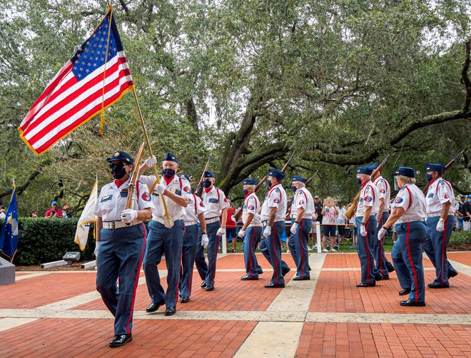 An honor guard marches the flag through Veterans Memorial Park during a Veterans Day ceremony at in The Villages on Wednesday, Nov. 11, 2020. [PAUL RYAN / CORRESPONDENT]