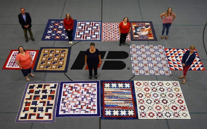 Farm Bureau Financial Services employees recognized 13 veteran colleagues for their military service, presenting them with handcrafted quilts during a virtual event.
