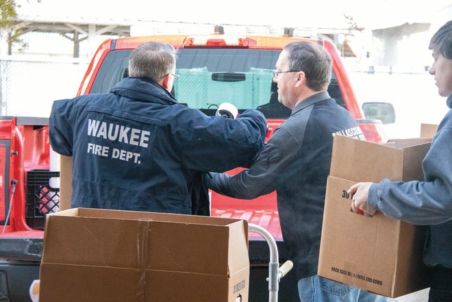 Boxes of food are loaded through the Dallas County Sheriff's County Benevolent's annual program in 2019 at the Dallas County Fairgrounds.