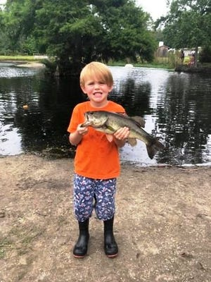 Holton Rawlins caught this bass in the Highland fish pond.