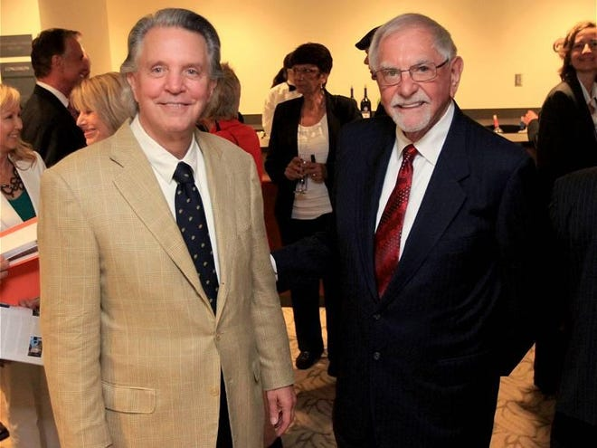 Mike Curb, left, and L. Gale Lemerand pose for a photo at a speaking engagement for Curb in Daytona Beach in 2013.
