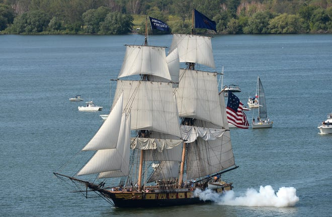 The U.S. Brig Niagara fires a cannon during the Tall Ships Erie festival's Parade of Sail on Aug. 22, 2019.