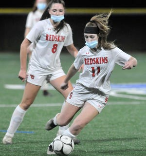 Lillian Mullen (11) of Canisteo-Greenwood sends the ball upfield during Tuesday's Class C1 game against Marcus Whitman.
