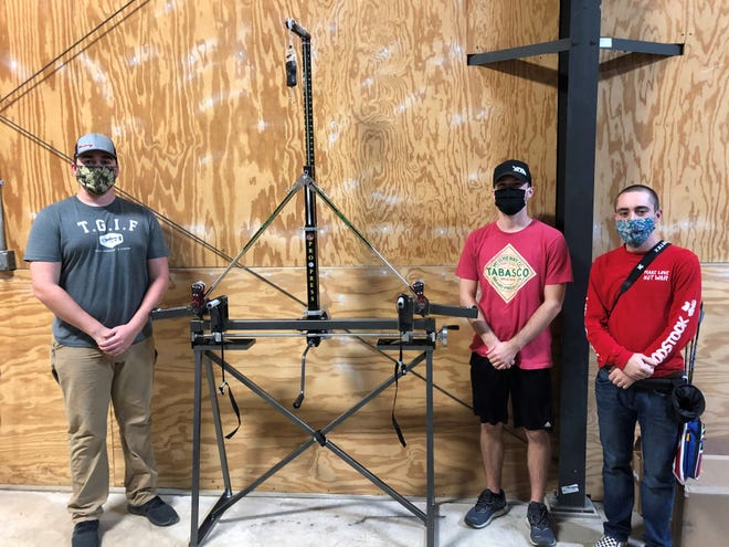 Alfred State Archery recently received an advanced Specialty Archery Pro Press system from Burdic's Bow Werx. The bow press is pictured here, along with Alfred State Archery team members, from left to right, Nathan Summerville, Robert Jaw Lawrence, and Simon Bond.