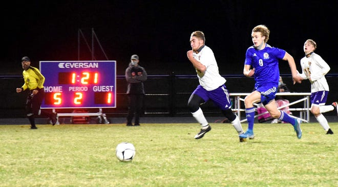 Poland Tornado Kade Ozog (9) races Dean Kousouros to the ball late in the second half of Tuesday's match, the first played fully under the lights on Poland's new field.