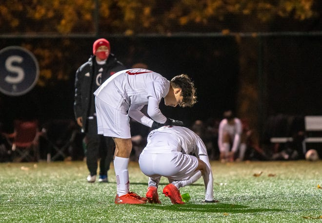 Van Horn sophomore Enil Arteaga, left, consoles senior forward Edison Rios after the Falcons fell 2-1 in overtime in a Class 3 state quarterfinal Tuesday at Swope Soccer Village. The Falcons finished one win away from their second state final four in three years.