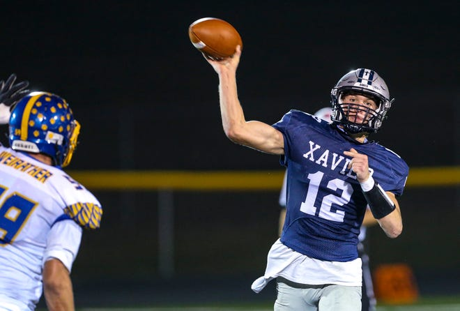 Xavier's Jaxon Rexroth (12) fires off a pass during the second quarter of their game Oct. 9 at Xavier High School in Cedar Rapids. (Andy Abeyta/The Gazette)