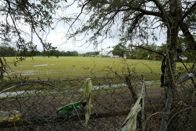 Even after a Superfund cleanup by the U.S. Environmental Protection Agency was finished, a chain-link fence topped with razor wire still surrounded Jacksonville's 12-acre Fairfax Street Wood Treaters site.