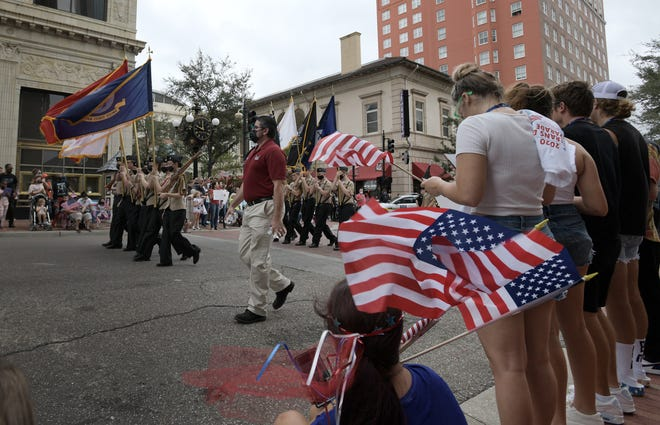 The annual Jacksonville Veterans Day Parade took a new route through downtown Jacksonville this year with active duty military, veterans organizations and support groups, ROTC participants and marching bands honoring those who have served in the military.