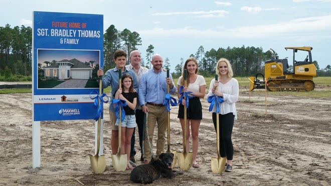 U.S. Marine Sgt. Bradley Thomas (center) and his family were surprised with a groundbreaking ceremony last month for their new home in Amelia Walk, courtesy of Lennar and Operation FINALLY HOME.