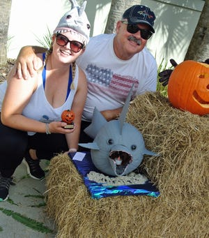 Katie and her dad Pete Morgan created a shark pumpkin that won best over all at the Sawgrass Country Club carved pumpkin contest.